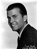 Dick Clark Posed in Black Suit With White Background