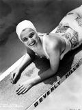 Carole Landis on a Printed Swimsuit Lying on a Dive Board