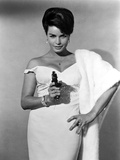 Senta Berger standing in White Dress with Pistol