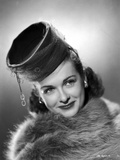 Joan Bennett on a Furry Cloth on Top and smiling