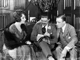 Betty Blythe sitting and Discussing with Two Men