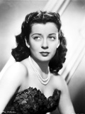 Gail Russell Posed in Corset and Pearl Necklace