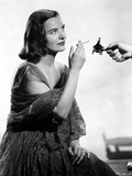 Ella Raines on a Dress and Lighting a Cigarette