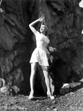 Carole Landis on Checkered Top and Skirt with Hand on Air