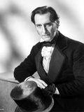 Peter Cushing sitting on Chair With Arm's Cross