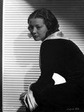 Sylvia Sidney sitting and posed in Black Dress