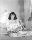 Gloria Grahame Holding Book Posed in a White Dress