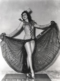 Ann Miller Spreading Her Skirt in a Classic Portrait