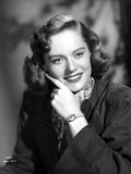 Alexis Smith smiling in Portrait with Wrist Watch