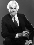 James Coburn in Black Suit With Black Background