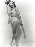 Julie Newmar Holding Hat in Lingerie Black and White