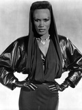 Grace Jones wearing Black Gown with Black Gloves