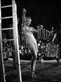 Anne Baxter on a Swimsuit Dancing and smiling