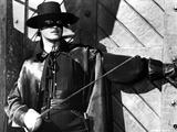 Guy Williams Riding Horse in Black Zorro Attire
