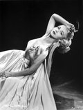 Carole Landis in a Dress and Leaning on Chair