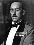 Alec Guinness Posed in Official Attire With Medals