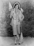 Gloria Swanson posed with Umbrella in Fur Coat