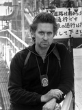 Michael Douglas Posed in Black Suit With Necklace