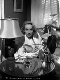 Marlene Dietrich sitting in White Long Sleeve