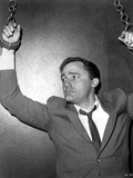 Robert Vaughn Hanging Two Hands in Black Suit