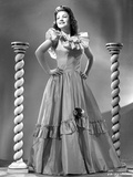 Anne Baxter on a Gown with Hands on the Waist