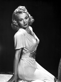 Carole Landis on a Dress sitting and Reclining