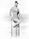 Esther Williams Leaning on Surfboard in Swimsuit
