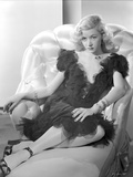 Gloria Grahame Posed on Couch wearing a Black Dress