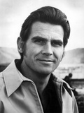 James Brolin Posed in Coat With White Background