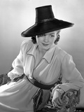Anne Baxter on a Long Sleeve sitting and Leaning