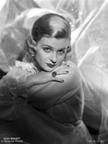 Joan Bennett on a Lace Top and Face Leaning on Hand