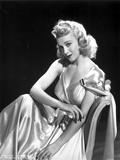 Carole Landis on a Silk Dress sitting and posed