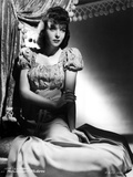 Ida Lupino on a Puff Sleeve sitting and posed