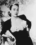 Joan Crawford Leaning on a Char wearing a Blouse
