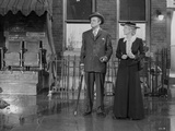 Citizen Kane Couple standing in Black Suit and Dress