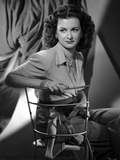 Joan Bennett sitting and Crossing Legs Portrait