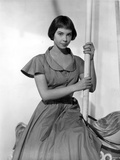 Leslie Caron posed with a Pole in Long Dress