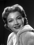 Anne Baxter on a Soft Coat smiling and posed