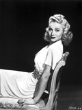 Carole Landis on a Dress sitting and posed