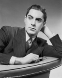 Tyrone Power Leaning on Couch Black and White