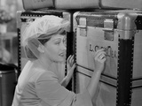 Gloria Swanson Writing Something on Luggage