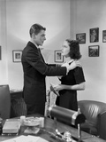 Ronald Reagan Holding a Woman on the Shoulders