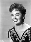 Ann Blyth on an Embroidered Top and smiling