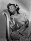 Gloria Swanson sitting in Classic Portrait