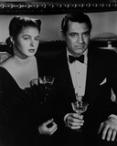 Notorious Couple Holding Wine Glass in Classic