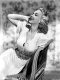 Carole Landis on a Dress sitting and Leaning