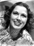 Eleanor Powell on a Sequin Top and smiling