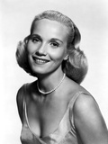 Eva Saint smiling in Classic with Necklace