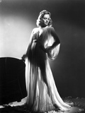 Alexis Smith standing wearing a Silk Robe