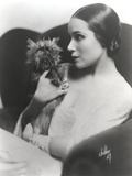 Dolores Del Rio Seated in Classic with a Dog